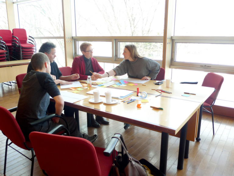 people making prototypes around a table